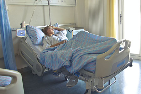 Hospital patient in bed waiting