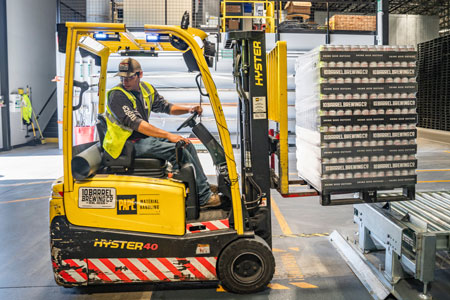 Industrial worker driving a forklift